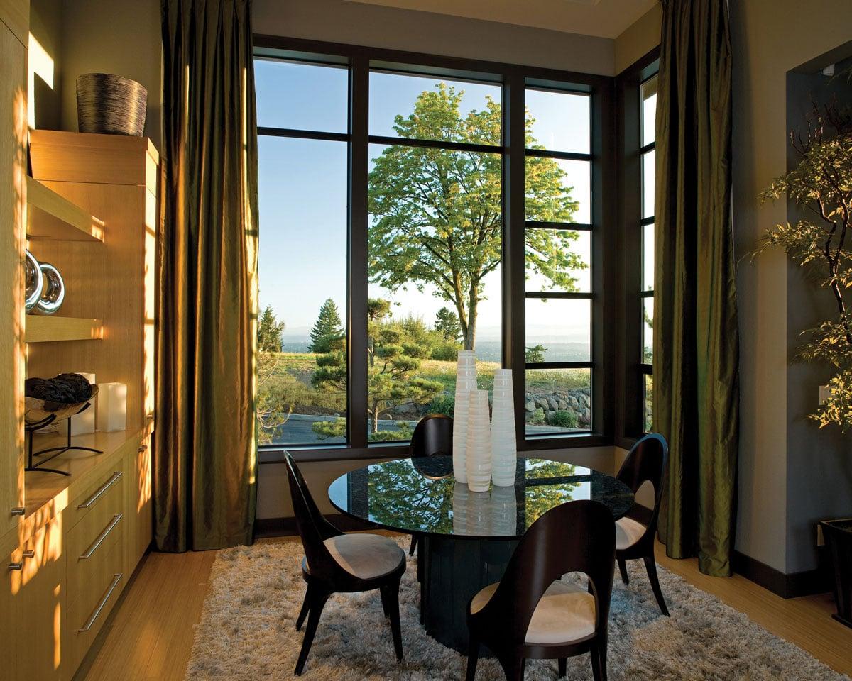 Beautiful big aluminum windows in a dining room