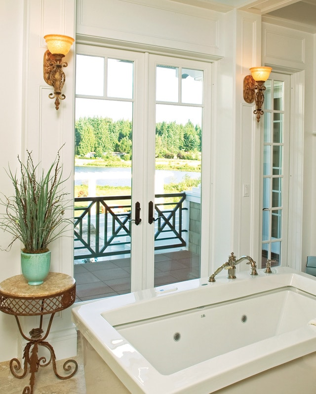 Beautiful French doors off a farmhouse-style bathroom