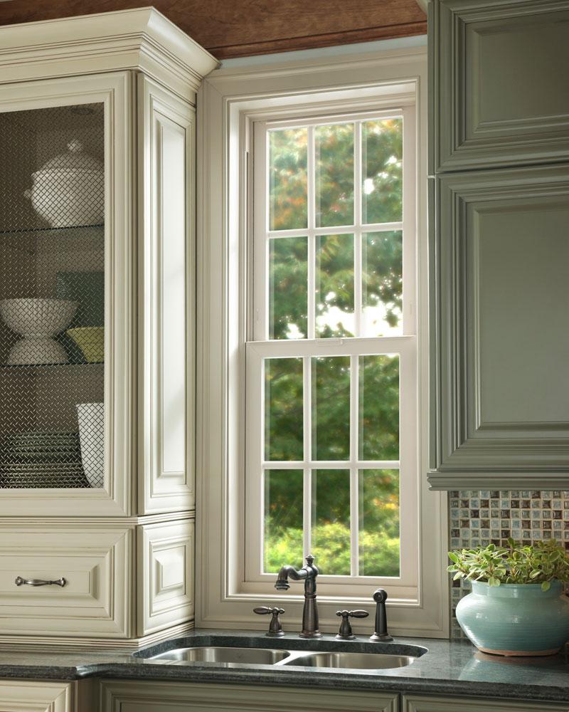 Beautiful traditional vinyl windows in a modern farmhouse-style kitchen