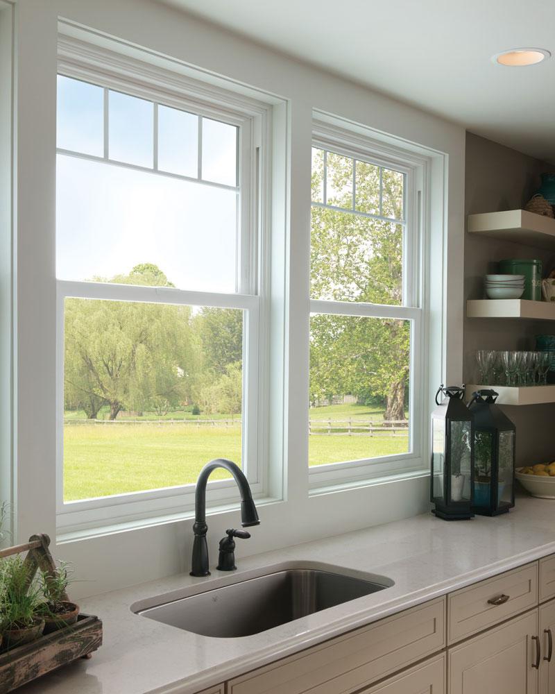 White vinyl windows in a farmhouse-style kitchen