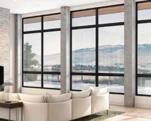 Large Milgard fiberglass windows are great for enjoying beautiful Okanagan views from your living room